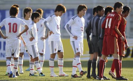 シリアに敗れ、うなだれる日本イレブン