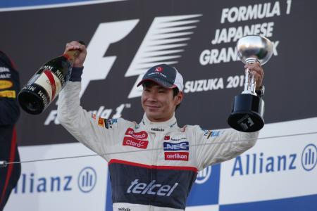 日本GPの表彰台で笑顔を見せる小林可夢偉 Sauber