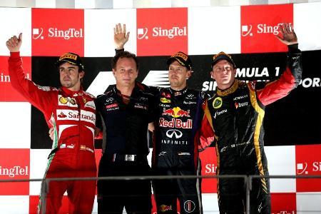 シンガポールGPの表彰台。左がアロンソ、右端がライコネン、右から2人目がフェテル Red Bull