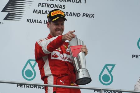 第2戦マレーシアGPで優勝し、喜ぶフェテル=Ferrari