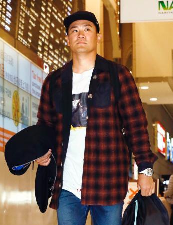 米国に向けて出発するヤンキースの田中=1日、成田空港