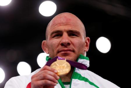 ロンドン五輪のレスリング男子フリースタイル120キロ級で金メダルを獲得したウズベキスタンのアルトゥール・タイマゾフ=2012年8月11日(ロイター=共同)