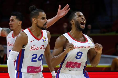 チュニジアに競り勝ち、喜ぶプエルトリコの選手たち=4日、広州(ロイター=共同)