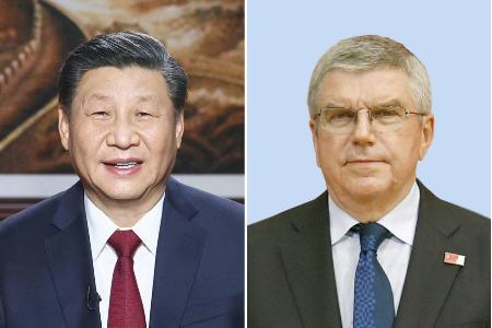中国の習近平国家主席(新華社=共同)、IOCのバッハ会長